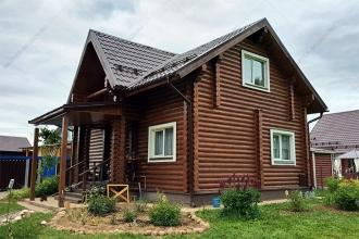 Покраска бревенчатого дома
